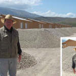 Bobby Burnette stands in the front of houses being built for the earthquake victims.