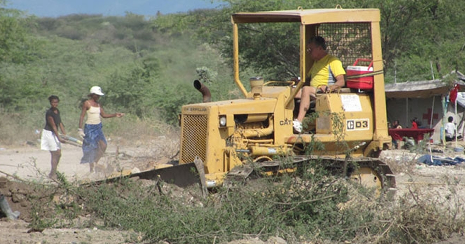 Our load is heavy! LAC is responsible for clearing all the land and digging all the wells.  Thank God for great volunteers...like Roger.