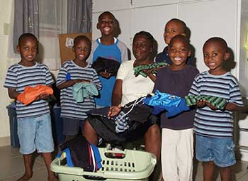 children doing laundry chores at the orphanage in Haiti
