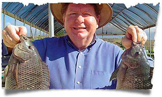 Bobby Burnette with our sustainability project - Love A Child's Tilapia Fish Farm in Haiti