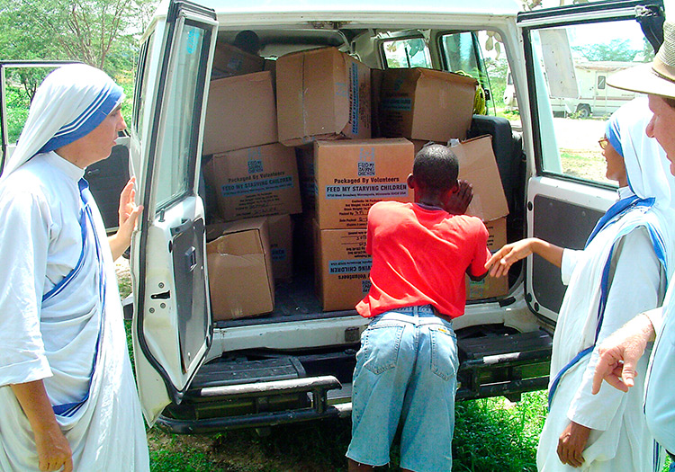 Missionazry nuns receiving food for their orphanage.