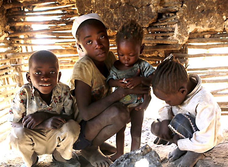 Poor Haitian children in mud hut