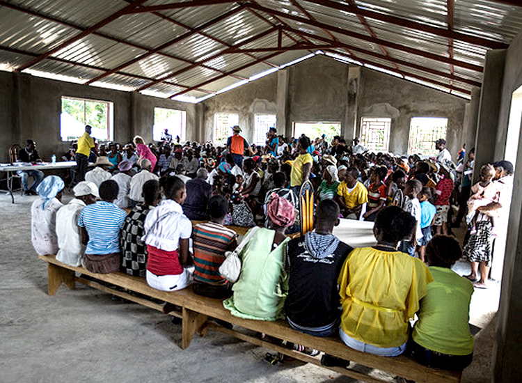 Haitian families waiting in new church to seek medical care