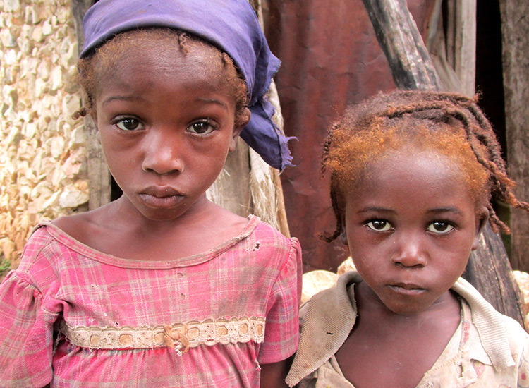 Two starving children in Haiti