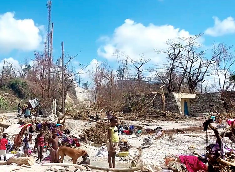 Hungry, sick and wounded poor people in Haiti after hurricane.