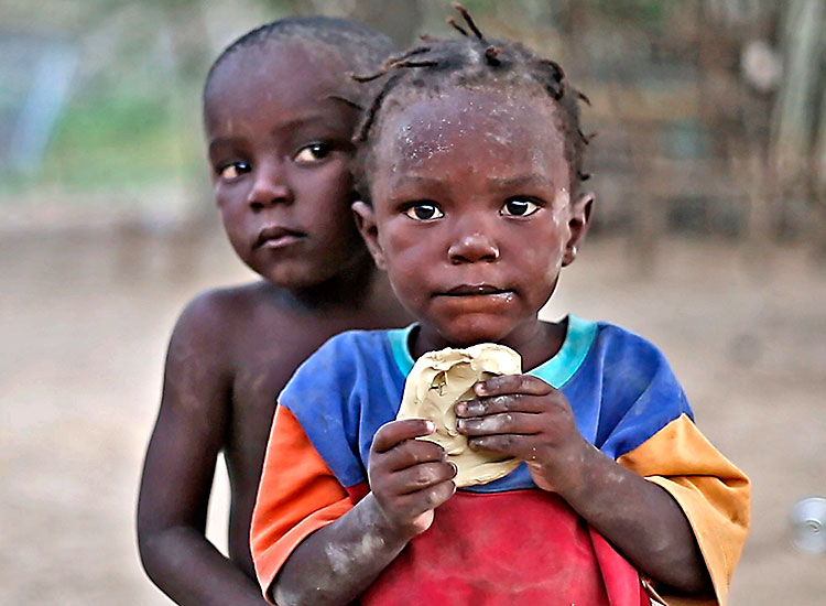 "Haitian children eating Bon Bon Tè"" (mud cookies)"