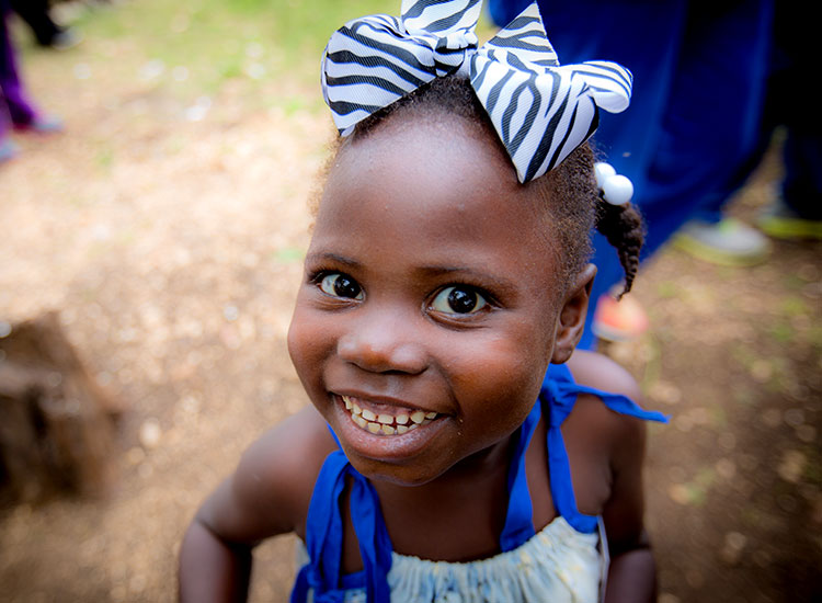 Child Sponsorship - happy young Haitian girl