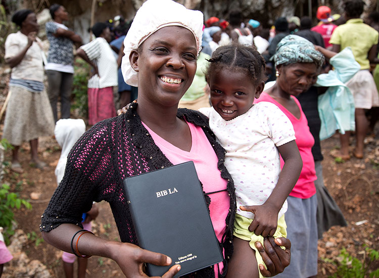 Haitan mother and child with Creole Bible
