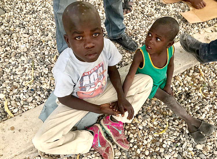Children suffering from malnutrition and skin infections.