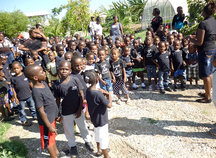 Haitian children from our Love A Child Miracle Village School visit the ATC.