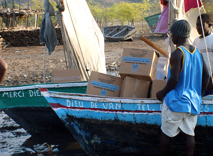 Picking up their food by boat in Letant, Haiti