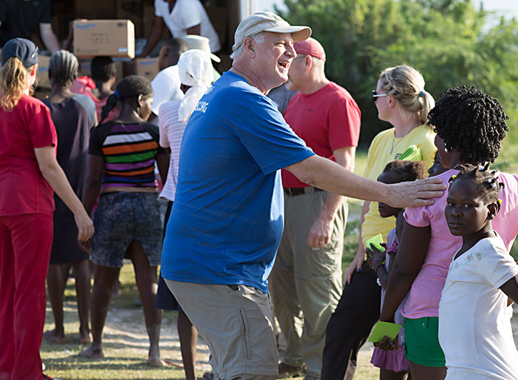 Mark Crea and his FMSC volunteer team help distribute food in Despeezo, Haiti.