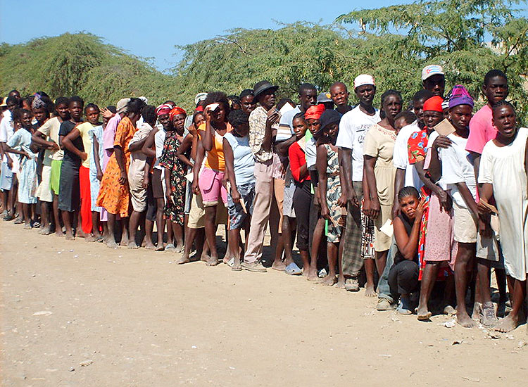 Haitians wait to pick up their boxes of food.