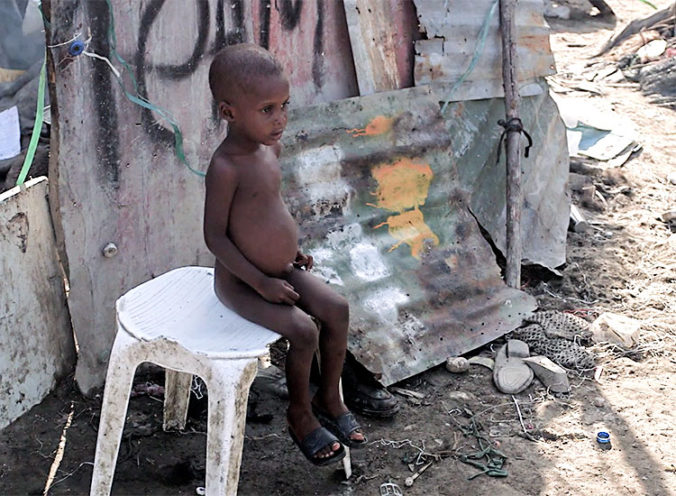 Children struggle to survive in the garbage dumps of Cité Soleil.