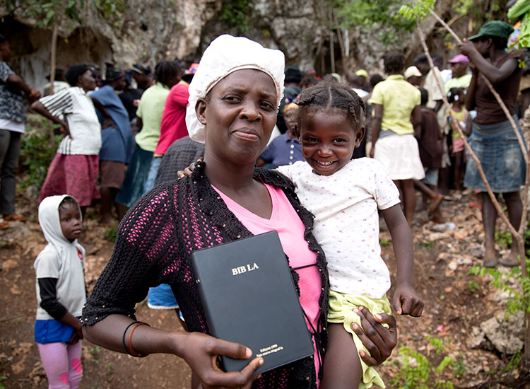 Haitian families living in the cave. Bobby took them food and Creole Bibles.