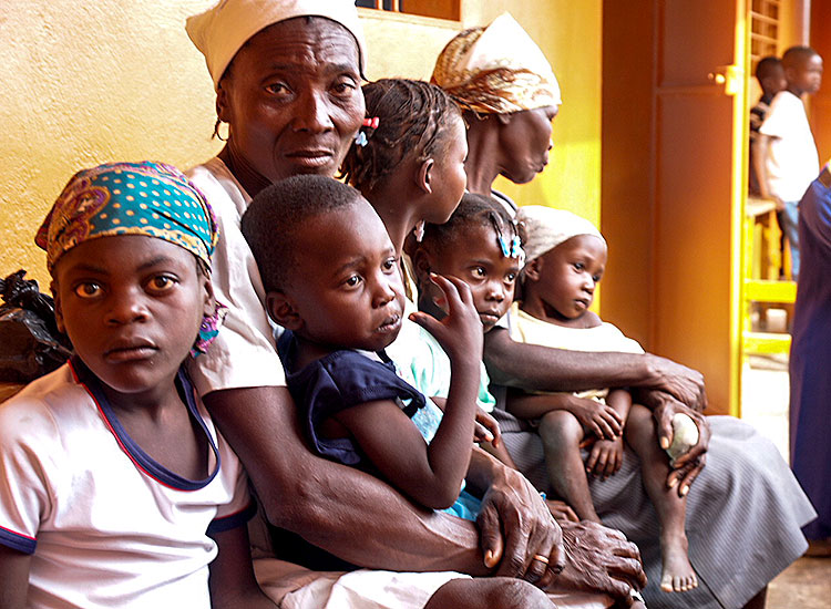 Grandmothers bring children to see a doctor and receive medication.