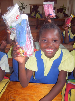 "This sponsored child in Haiti's big smile says ""Thank You"" to her loving sponsors."