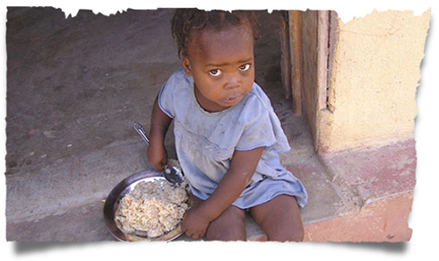 A young girl with food that Love A Child distributes throughout Haiti.