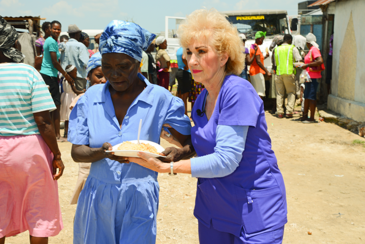 Sherry helping lady with food