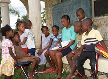 Helping the children with homework at our orphanage in Haiti
