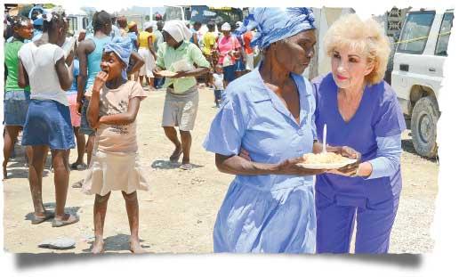 Sherry Burnette during a Feeding Program in Haiti