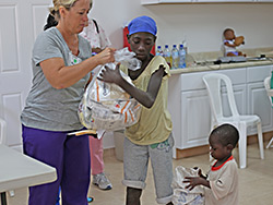 A young mother learning at our Malnutrition Center in Haiti