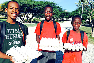 Orphans gather eggs at Love A Child's chicken farm in Haiti