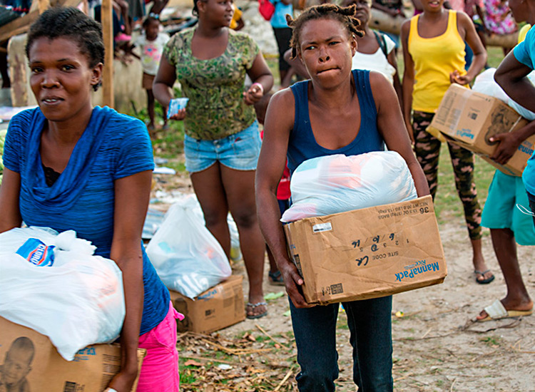 Haitians receiving disaster relief food and supplies.