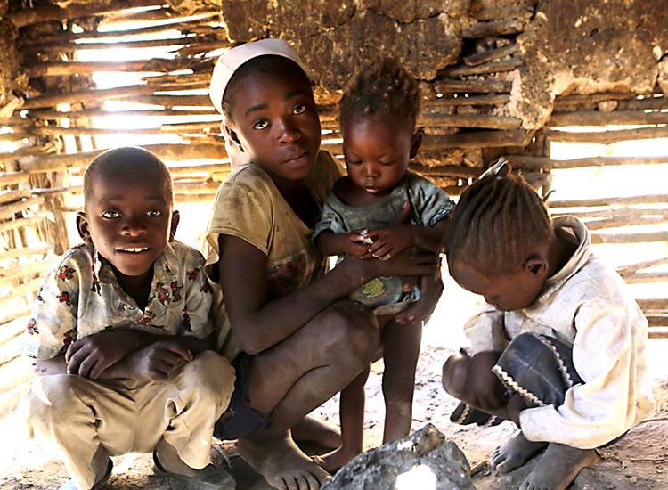 Poor Haitian children in mud hut