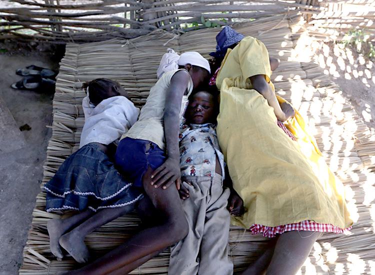 Sleeping on straw mats in mud huts