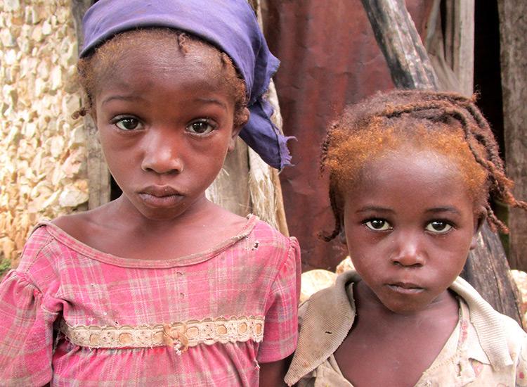 Two starving children in Haiti