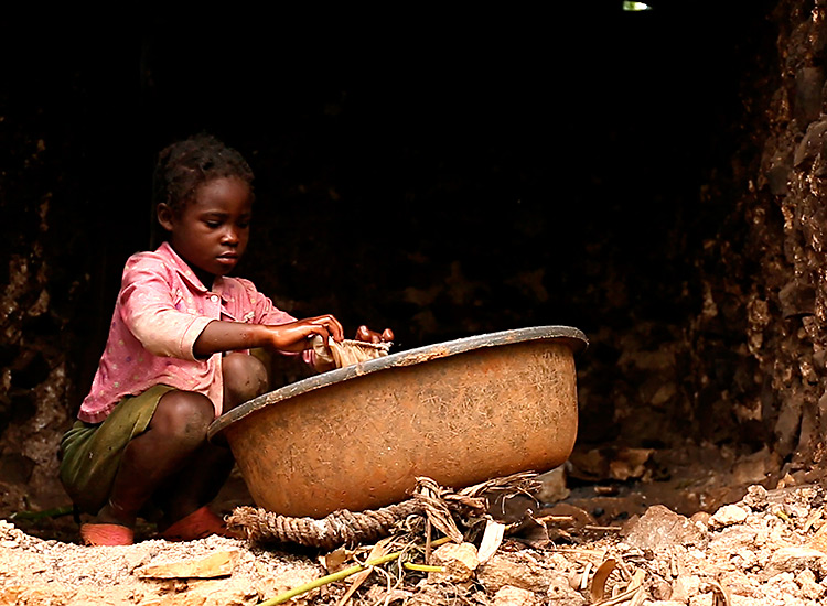 Young Haitian girl washing family's clothes