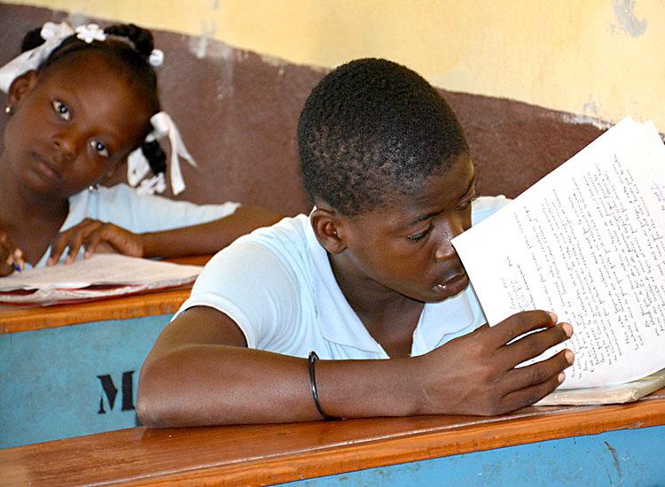 Haitian boy-studying in school
