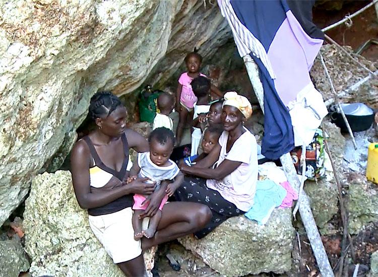 Haitian families inside caves.