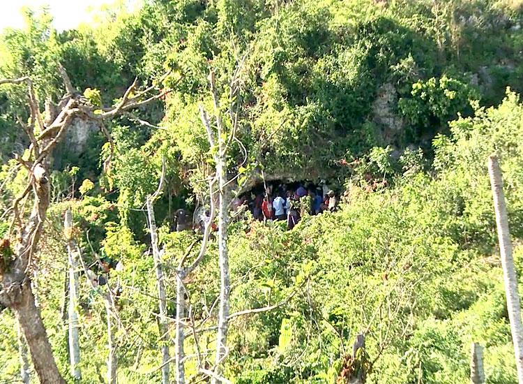 Haitians living in mountain caves after Hurricane Matthew.