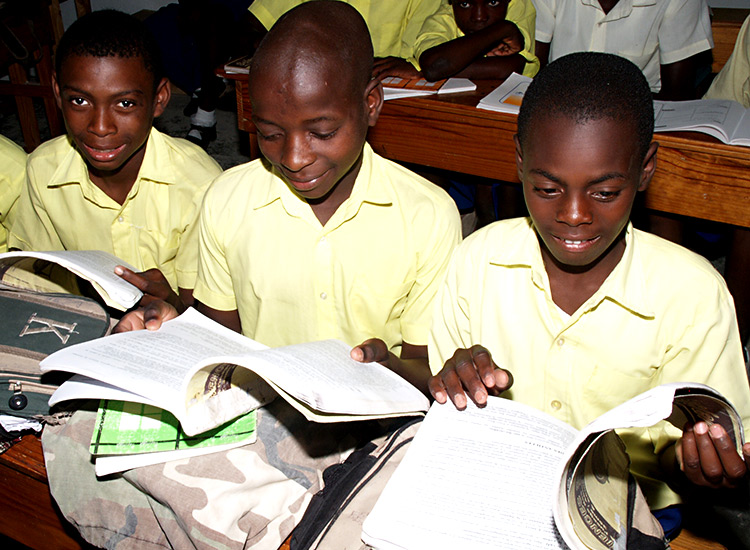 Secondary school students with workbooks