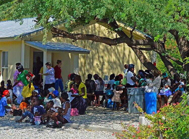 Haitians line up for the Malnutrition Center.