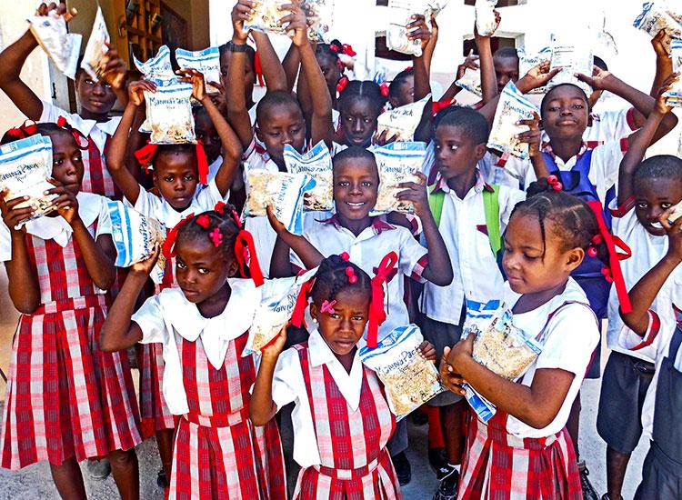 Feeding orphanage children in Haiti.