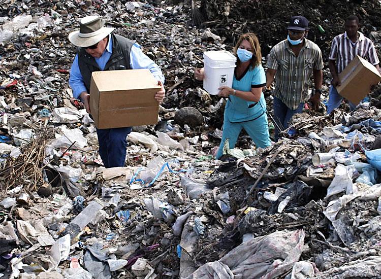 Our feeding program in places like the Truttier Waste Disposal Dump.