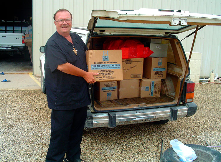 Missionaries pick up their boxes of food at the warehouse.
