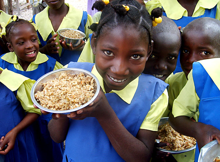 School children receive a hot nutritious meal each day.