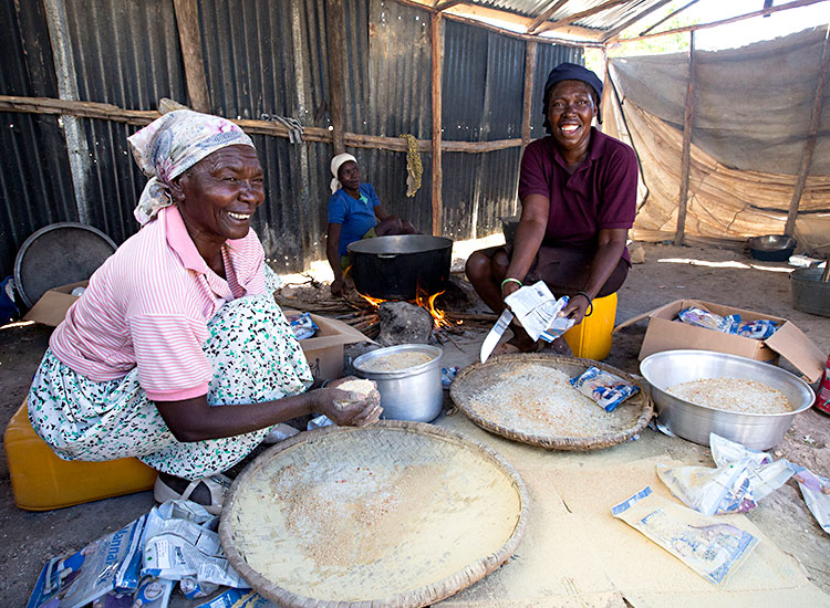 Haitian ladies cooking for the children in the Feeding Program