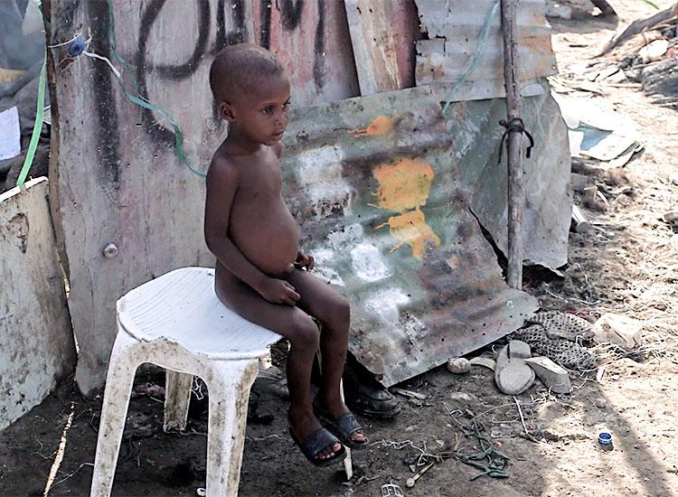 Children struggle to survive in the garbage dumps of Cité Soleil.