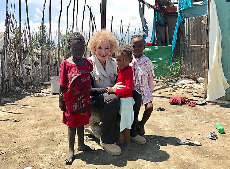 God Bless the Children living in the slums of Cité Soleil.