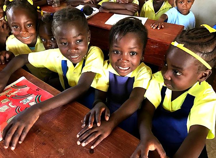 Happy children attending school.