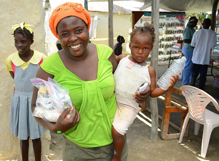 Woman getting medicine for sick child