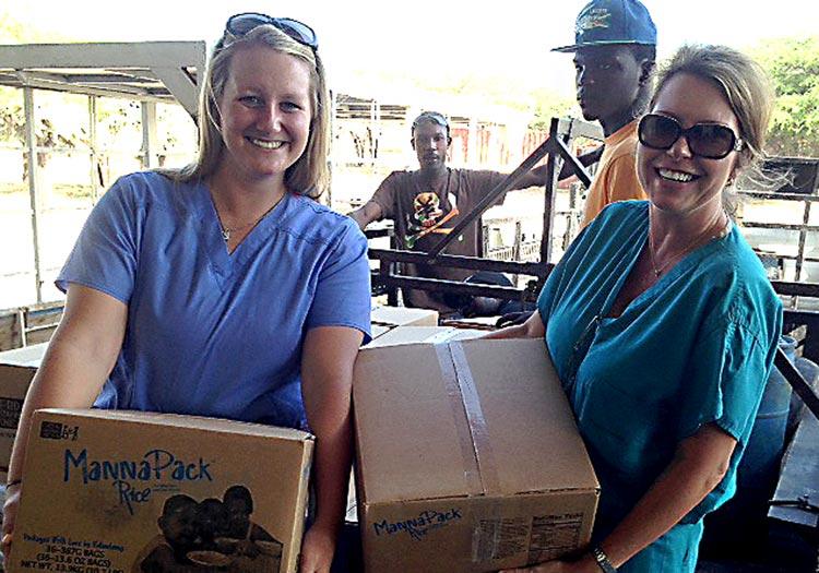 Kaeli and Julie heling on Food Distribution Day.