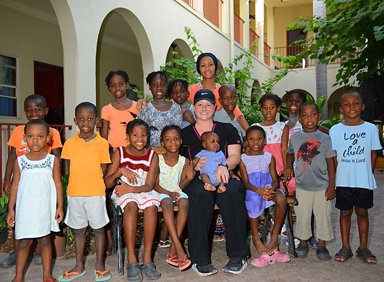 Kaeli, with some of the children at our Love A Child Children's Home.