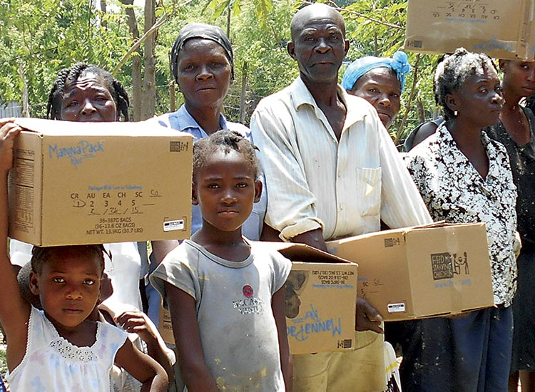 Bringing food to the poor people in Sapaterre.
