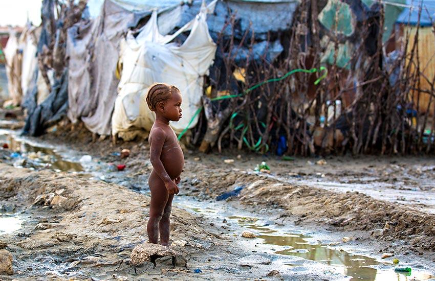 Poor child the area of Rapatrié, Haiti.